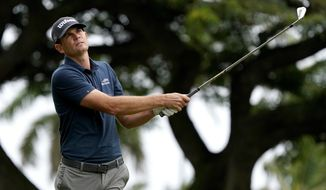 Brendan Steele hits from the fourth tee during the final round of the Sony Open PGA Tour golf event, Sunday, Jan. 12, 2020, at Waialae Country Club in Honolulu. (AP Photo/Matt York)