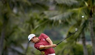 Cameron Smith hits from the third fairway during the final round of the Sony Open PGA Tour golf event, Sunday, Jan. 12, 2020, at Waialae Country Club in Honolulu. (AP Photo/Matt York)