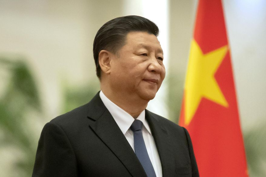 In this Jan. 6, 2020, file photo, Chinese President Xi Jinping stands during a welcome ceremony for Kiribati's President Taneti Maamau at the Great Hall of the People in Beijing. (AP Photo/Mark Schiefelbein, File)
