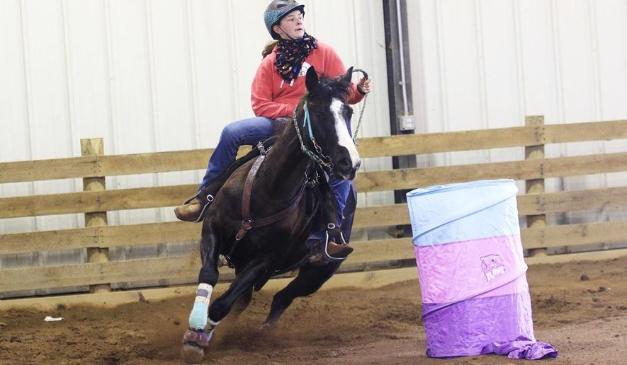 Josi Davis, of Union, practices barrel racing in Lewisburg on Jan. 3, 2020. Davis was named athlete of the month by National High School Rodeo Magazine, despite suffering from an immune deficiency disorder for which she receives an IV infusion every three weeks.  (Jenny Harnish/The Register-Herald via AP)