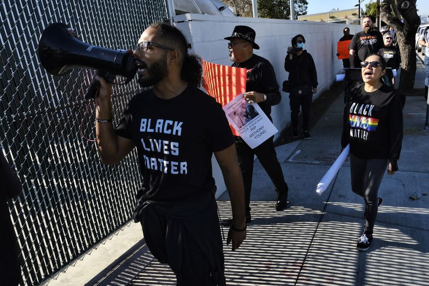 Protesters with Black Lives Matter protest a visit by Democratic presidential candidate and former South Bend, Ind., Mayor Pete Buttigieg, at A Bridge Home Project homeless shelter in Los Angeles, Friday, Jan. 10, 2020. (AP Photo/Richard Vogel)