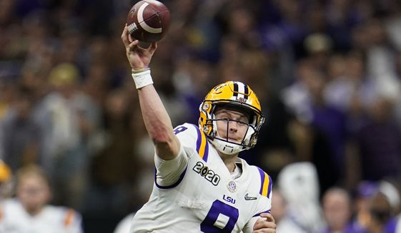 LSU quarterback Joe Burrow passes against Clemson during the second half of a NCAA College Football Playoff national championship game Monday, Jan. 13, 2020, in New Orleans. (AP Photo/David J. Phillip)
