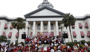 Thousands rallied and marched from the Donald L. Tucker Civic Center to the Florida Historic Capitol to demand more money for public schools Monday, Jan. 13, 2020. Thousands of school workers from around the state thronged Florida's Capitol on Monday to press Gov. Ron DeSantis and the Legislature to more than double the nearly $1 billion the governor is proposing for teacher raises and bonuses.  (Tori Lynn Schneider/Tallahassee Democrat via AP)