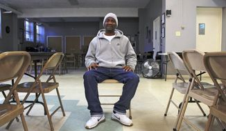 "In this Dec. 11, 2019, photo, Quentin Blackburn poses for a photo in Milwaukee. Blackburn is a felon who didn't realize he could vote when his probation was finished. ""When I became a felon, it was like something was stripped from me,"" he said. ""I felt like I didn't matter, you know, in a sense. So now I can vote now. It's good news. I'm happy."" (AP Photo/Carrie Antlfinger)"