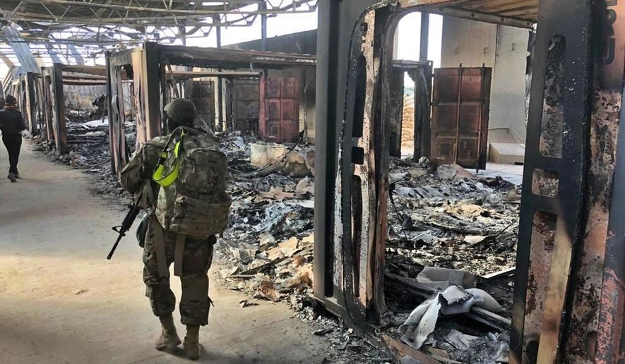 U.S. soldiers walk past a site of Iranian bombing at Al Asad Air Base, in Anbar, Iraq, Monday, Jan. 13, 2020.  (Associated Press) **FILE**