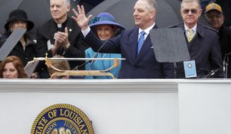 Louisiana Gov. John Bel Edwards waves to the crowd during his inauguration at the state Capitol in Baton Rouge, La., Monday, Jan. 13, 2020. (AP Photo/Brett Duke)