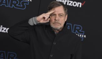 """File - In this Dec. 16, 2019, file photo, Mark Hamill arrives at the world premiere of """"Star Wars: The Rise of Skywalker"""" in Los Angeles. The force was strong enough at an Arizona store to reunite Luke Skywalker with his long-lost vinyl record. Hamill is praising workers at Bookmans Entertainment Exchange in Flagstaff for returning the """"Star Wars: A New Hope"""" soundtrack that had been a gift from film composer John Williams. Hamill said in a tweet Saturday, Jan. 11, 2020, that it felt """"totally unexpected & positively surreal"""" to get back the record he had not seen since the early 1990s. He commended the store about 145 miles (233 kilometers) north of Phoenix for being honest and not selling it. (Jordan Strauss/Invision/AP, File)"""