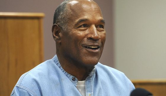 In this July 20, 2017, file photo, former NFL football star O.J. Simpson appears via video for his parole hearing at the Lovelock Correctional Center in Lovelock, Nev. (Jason Bean/The Reno Gazette-Journal via AP, Pool) ** FILE **