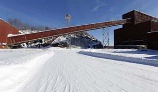 """FILE - This Feb. 10, 2016 file photo shows a former iron ore processing plant near Hoyt Lakes, Minn., that would become part of a proposed PolyMet copper-nickel mine. The Minnesota Court of Appeals has rejected two of the most important permits for the planned PolyMet copper-nickel mine in northeastern Minnesota in a major victory for environmentalists. A three-judge panel ruled Monday, Jan. 13, 2019, that the state Department of Natural Resources erred when it declined to order a proceeding known as a """"contested case hearing"""" to gather more information on the potential environmental impacts of the project. (AP Photo/Jim Mone, File)"""