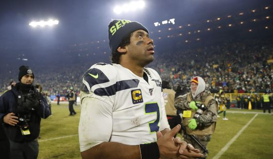 Seattle Seahawks' Russell Wilson walks off the field after an NFL divisional playoff football game against the Green Bay Packers Sunday, Jan. 12, 2020, in Green Bay, Wis. The Packers won 28-23 to advance to the NFC Championship. (AP Photo/Matt Ludtke)