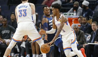 Oklahoma City Thunder's Mike Muscala, left, sets a pick for Shai Gilgeous-Alexander, right, of Canada as he drives past Minnesota Timberwolves' Josh Okogie of Nigeria in the first half of an NBA basketball game Monday, Jan. 13, 2020, in Minneapolis. (AP Photo/Jim Mone)