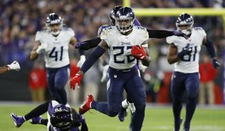 Tennessee Titans running back Derrick Henry (22) runs past Baltimore Ravens strong safety Chuck Clark (36) during the second half of an NFL divisional playoff football game, Saturday, Jan. 11, 2020, in Baltimore. (AP Photo/Julio Cortez) **FILE**