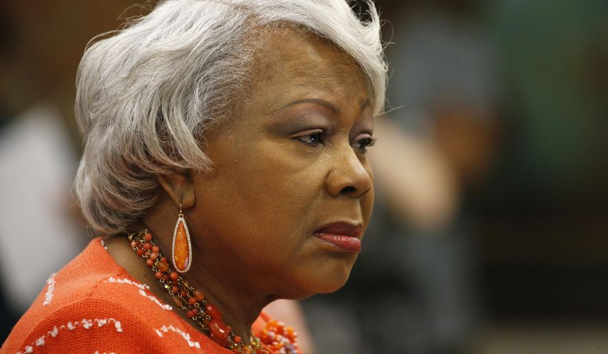 State Sen. Louise Lucas D-Portsmouth, listens during the meeting of the Senate Judiciary committee at the Capitol in Richmond, Va., Monday, Jan. 13, 2020. Lucas sponsored a bill calling for one gun a month gun purchases which passed the committee. (AP Photo/Steve Helber)