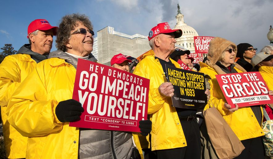 Colleen Deaver of Pasadena, Maryland, (left) joins a rally led by the House Freedom Caucus in support of President Trump earlier this month. The Senate has yet to receive the articles of impeachment. (Associated Press)