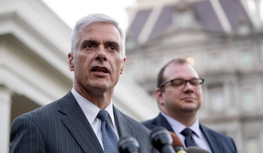 Club for Growth president David McIntosh, left, accompanied by FreedomWorks President Adam Brandon, right, speaks to members of the media outside the West Wing of the White House, Wednesday, March 8, 2017, in Washington. President Donald Trump met with conservative leaders about healthcare. (AP Photo/Andrew Harnik) **FILE**