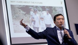 Democratic presidential candidate Andrew Yang speaks as he presents a PowerPoint presentation at a campaign stop at the Octagon Center for the Arts, Tuesday, Jan. 14, 2020, in Ames, Iowa. (AP Photo/Andrew Harnik)