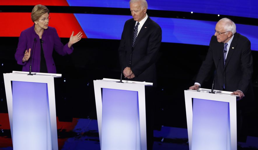 Democratic presidential candidate Sen. Elizabeth Warren, D-Mass., left, speaks to Sen. Bernie Sanders, I-Vt., right as former Vice President Joe Biden watches Tuesday, Jan. 14, 2020, during a Democratic presidential primary debate hosted by CNN and the Des Moines Register in Des Moines, Iowa. (AP Photo/Patrick Semansky)