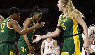 Baylor forward Lauren Cox (15) celebrates with teammate Moon Ursin in the second half of an NCAA college basketball game against Oklahoma in Norman, Okla., Saturday, Jan. 4, 2020. (AP Photo/Sue Ogrocki)