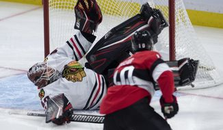 Chicago Blackhawks goaltender Robin Lehner sprawls across the crease to make a save on Ottawa Senators left wing Anthony Duclair (10) during second period NHL hockey action in Ottawa, Tuesday, Jan. 14, 2020. (Adrian Wyld/The Canadian Press via AP)