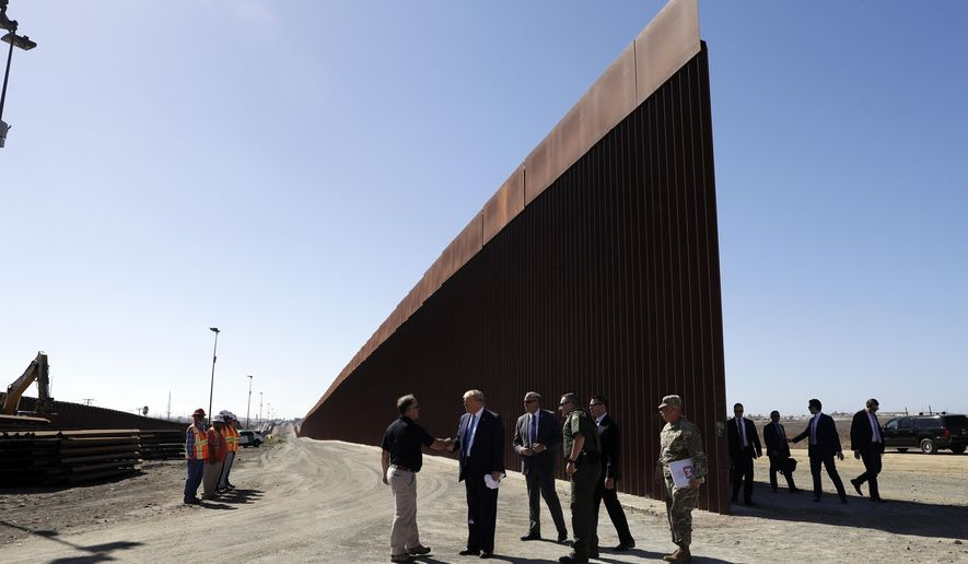 FILE - In this Sept. 18, 2019, file photo, President Donald Trump tours a section of the southern border wall in Otay Mesa, Calif. The Trump administration is weighing whether to shift billions more in military funding for the border wall after moving more than $6 billion, prompting a fresh round of criticism from lawmakers (AP Photo/Evan Vucci, File)