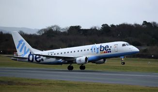 A Flybe flight departs from Manchester Airport, England, Monday Jan. 13, 2020. Britain's leaders are considering whether to support a rescue deal for the struggling regional airline Flybe, with discussions under way as to whether the carrier should receive tax relief on passenger duty levies. (Pete Byrne/PA via AP)