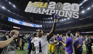 LSU cornerback Kristian Fulton leaves the field after a NCAA College Football Playoff national championship game against Clemson, Monday, Jan. 13, 2020, in New Orleans. LSU won 42-25. (AP Photo/Gerald Herbert)