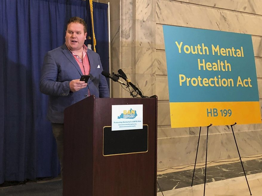 Filmmaker Zach Meiners speaks at a rally on Tuesday, Jan. 14, 2020, in Frankfort, Ky., in support of legislation aimed at effectively banning the practice of conversion therapy in Kentucky. Conversion therapy attempts to change a person's sexual orientation or gender identity. (AP Photo/Bruce Schreiner)