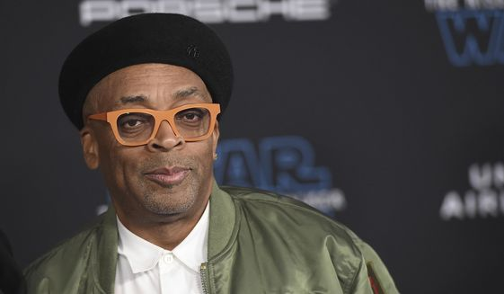 """In this Dec. 16, 2019, file photo, Spike Lee arrives at the world premiere of """"Star Wars: The Rise of Skywalker"""" in Los Angeles. Spike Lee will lead the jury of this year's Cannes Film Festival, and festival organizers hope the provocative American director will """"shake things up"""" at the gathering of the world's cinema elite. (Jordan Strauss/Invision/AP, File )"""