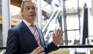 Britain's Nigel Farage, the leader of the Brexit Party, answers reporters at the European parliament Tuesday, Jan.14, 2020 in Strasbourg, eastern France. (AP Photo/Jean-Francois Badias)