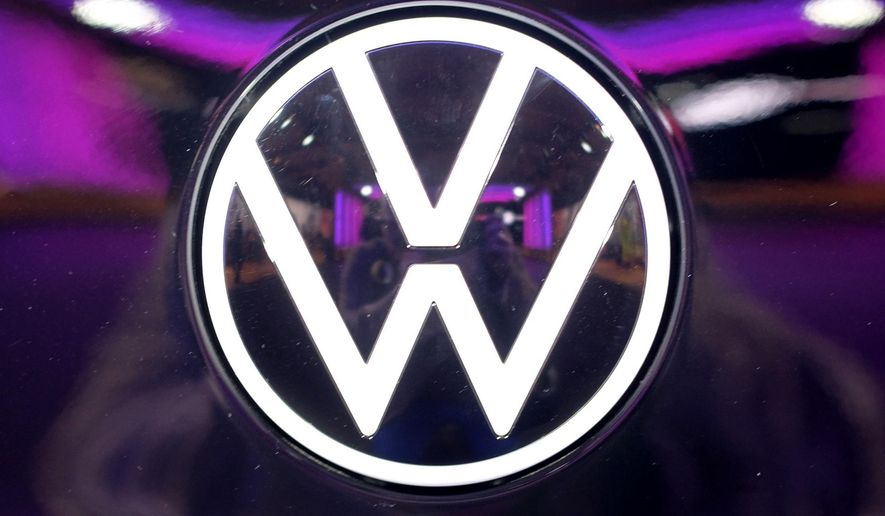 File---Picture taken on Nov.4, 2019 shows the VW logo on a car at a VW factory opening ceremony for electric cars in Zwickau,  Germany. (Sebastian Willnow/dpa via AP)