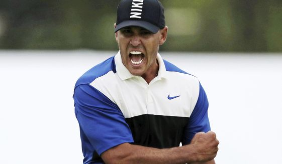 FILE - Brooks Koepka reacts after sinking a putt on the 18th green to win the PGA Championship golf tournament, Sunday, May 19, 2019, at Bethpage Black in Farmingdale, N.Y. Koepka says his play out of an awkward lie on the 18th that led to par was one of his most important shots. (AP Photo/Charles Krupa)