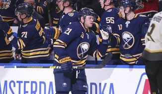 Buffalo Sabres forward Kyle Okposo (21) celebrates his goal during the second period of an NHL hockey game against the Vegas Golden Knights, Tuesday, Jan. 14, 2020, in Buffalo, N.Y. (AP Photo/Jeffrey T. Barnes)