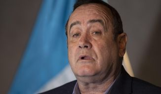 Guatemala's President-elect Alejandro Giammattei gives a press conference at the National Theatre, the day before his inauguration in Guatemala City, Monday, Jan. 13, 2020. Giammattei will be sworn-in as the 51st president of Guatemala on Jan. 14. (AP Photo/Moises Castillo)