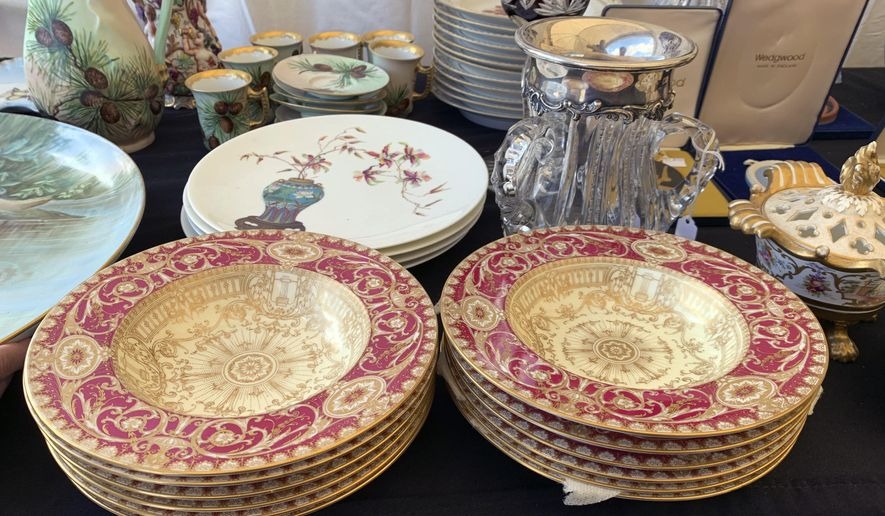 This Sept. 7, 2019 photo provided by Tracee Herbaugh shows some of the china for sale at a flea market in Brimfield, Mass. China has become a staple at flea markets, as younger people opt to sell or donate heirloom dishware. (Tracee Herbaugh via AP)