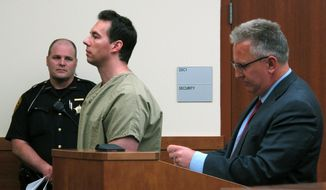 FILE - In this June 5, 2019 file photo former critical care doctor William Husel, center, pleads not guilty to murder charges while appearing with defense attorney Richard Blake, right, in Franklin County Court in Columbus, Ohio. This week marks a year since an Ohio hospital system announced a doctor ordered excessive painkillers for dozens of patients who then died. William Husel pleaded not guilty to murder charges in the deaths of 25 patients in the Columbus-area Mount Carmel Health System. (AP Photo/Kantele Franko, File)