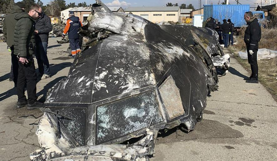 """This undated photo provided by the Ukrainian Presidential Press Office, shows the wreckage of the Ukraine International Airlines Boeing 737-800 at the scene of the crash in Shahedshahr, southwest of the capital Tehran, Iran. Iran has acknowledged that its armed forces """"unintentionally"""" shot down the Ukrainian jetliner that crashed earlier this week, killing all 176 aboard, after the government had repeatedly denied Western accusations that it was responsible. (Ukrainian Presidential Press Office via AP)"""