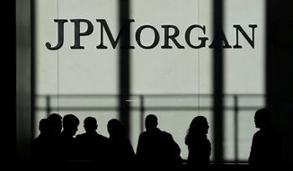 In this Oct. 21, 2013, file photo, the JPMorgan Chase logo is displayed at their headquarters in New York. Banking giant JPMorgan Chase said that its fourth-quarter profits jumped 21% from a year earlier, as the bank's trading desks had a blowout quarter. A sharp increase in JPMorgan's trading business made up for declining interest rates, which impacted other parts of the bank. (AP Photo/Seth Wenig, File)
