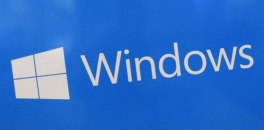 This Aug. 7, 2017, file shows a Microsoft Widows sign on display at a store in Hialeah, Fla. The National Security Agency has discovered a major security flaw in Microsoft's Windows operating system. Microsoft says the NSA notified the company about it. A fix was made available Tuesday, Jan. 14, 2020. (AP Photo/Alan Diaz)