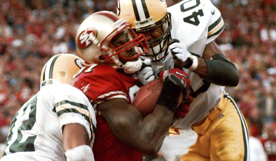 FILE - In this Jan. 3, 1999, file photo, San Francisco 49ers' wide receiver Terrell Owens pulls in a 25-yard touchdown pass from quarterback Steve Young as Green Bay Packers' safeties Pat Terrell (40) and Darren Sharper defend late in the fourth quarter of an NFC wild card playoff game at 3COM Park in San Francisco. Owens' catch with three seconds left in the game led the 49ers to a 30-27 win. The two teams that have combined for nine Super Bowl titles will meet with a spot in the ultimate game on the line once again when the 49ers (14-3) host the Packers (14-3) in the NFC championship game on Sunday, Jan. 19, 2020. (AP Photo/Susan Ragan) ** FILE **