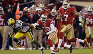 FILE - In this Jan. 12, 2013, file photo, San Francisco 49ers quarterback Colin Kaepernick (7) runs for a 56-yard touchdown against the Green Bay Packers during the third quarter of an NFC divisional playoff NFL football game, in San Francisco. The two teams that have combined for nine Super Bowl titles will meet with a spot in the ultimate game on the line once again when the 49ers (14-3) host the Packers (14-3) in the NFC championship game on Sunday, Jan. 19, 2020. (AP Photo/Marcio Jose Sanchez, File)