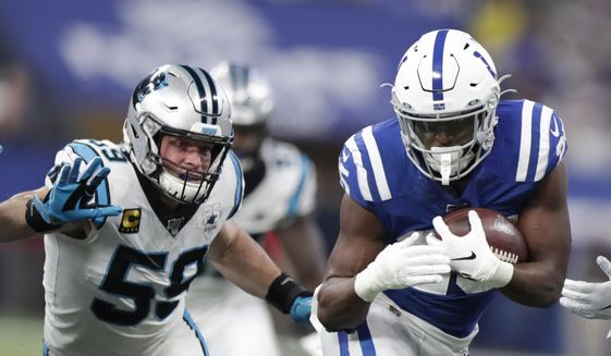 Indianapolis Colts running back Marlon Mack (25) runs past Carolina Panthers' Luke Kuechly (59) during the first half of an NFL football game, Sunday, Dec. 22, 2019, in Indianapolis. (AP Photo/Michael Conroy) **FILE**