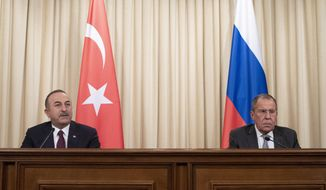 Turkish Foreign Minister Mevlut Cavusoglu, left, and Russian Foreign Minister Sergey Lavrov attend a joint news conference following their talks in Moscow, Russia, Monday, Jan. 13, 2020. Foreign and defense ministers of Russia and Turkey met as part of an effort by Moscow and Ankara to sponsor Monday's talks between rival parties in Libya in the Russian capital. (AP Photo/Pavel Golovkin, Pool)