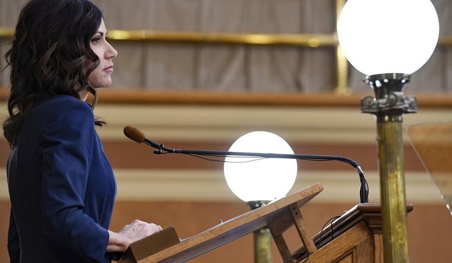South Dakota Gov. Kristi Noem delivers the annual State of the State address in the House Chamber at the state Capitol, Tuesday, Jan. 14, 2020, in Pierre, S.D. (Erin Bormett/The Argus Leader via AP)