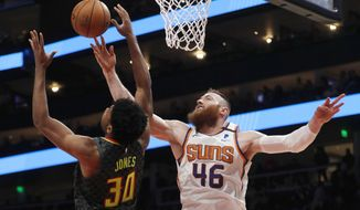 Phoenix Suns center Aron Baynes (46) battles Atlanta Hawks center Damian Jones (30) for a rebound in the first half of an NBA basketball game Tuesday, Jan. 14, 2020, in Atlanta. (AP Photo/John Bazemore)