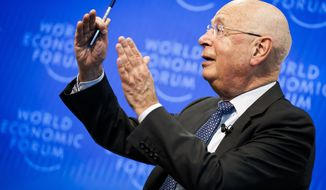 """Klaus Schwab, Founder and Executive Chairman of the World Economic Forum, WEF, gestures during a press conference, in Cologny near Geneva, Switzerland, Tuesday, January 14, 2020. The World Economic Forum unveiled the program for its 50th Annual Meeting in Davos, Switzerland, including the key participants, themes and goals. The overarching theme of the Meeting, which will take place from 21 to 24 January, is """"Stakeholders for a cohesive and sustainable world"""".(Valentin Flauraud/Keystone via AP)"""