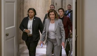 Speaker of the House Nancy Pelosi, D-Calif., arrives at the Capitol in Washington, Friday, Jan. 10, 2020. Pelosi hasn't relayed the articles of impeachment to the Senate for trial three weeks since President Donald Trump was impeached on charges of abuse and obstruction. Last night, she led the Democrat-controlled House in passing a measure limiting Trump's ability to take military action against Iran after he ordered the U.S. killing of a top Iranian general. (AP Photo/J. Scott Applewhite)