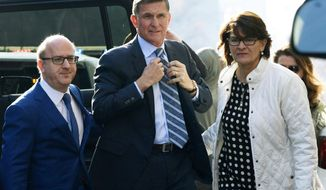 In this Dec. 1, 2017, file photo, Michael Flynn, center, arrives at federal court in Washington.  (AP Photo/Susan Walsh, File) **FILE**