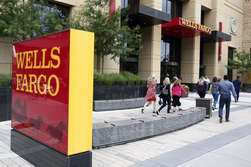 In this July 10, 2019, photo a Wells Fargo building is shown in downtown Minneapolis. (AP Photo/Jim Mone) **FILE**