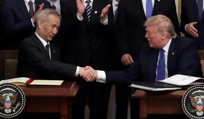 President Trump and Chinese Vice Premier Liu He signed a trade agreement Wednesday at the White House without any U.S. concessions on the Justice Department's case against Huawei Technologies. (Associated Press)