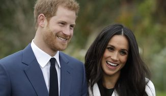 In this Monday, Nov. 27, 2017 file photo, Britain's Prince Harry and his then-fiancee Meghan Markle pose for photographers during a photocall in the grounds of Kensington Palace in London. (AP Photo/Matt Dunham, File)